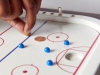 Across The Board: Wooden Tabletop Penny Hockey..